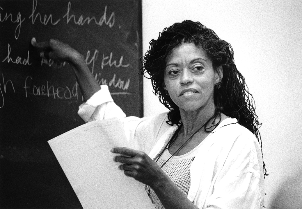 female instructor pointing to chalk board