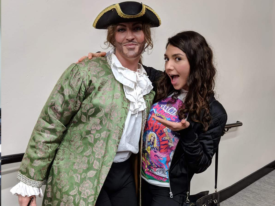 two student, one in costume
